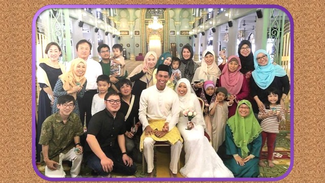 "After the marriage solemnisation (nikah) at the Sultan Mosque, Singapore: ""A recent marriage of a Japanese, Youngri, to a Singaporean, Ridzwan. With them are Japanese converts who came to support the occasion,"" says Ms Keiki Soada who is wearing a black scarf (second from right). ""Eleven Japanese converts residing in Singapore gathered to join in the celebration representing the bride side."" (Photo credit: Keiko Soada)"